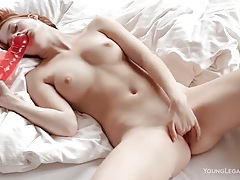 Redhead sucks big dildo and plays with pussy tubes