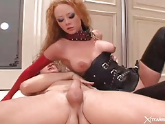 Latex whore on a leash laid in her asshole tubes
