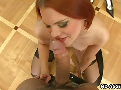 Shaved redhead in black stockings sucks cock tubes