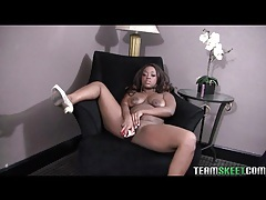 Solo black chick fucks a white dildo into her pussy tubes