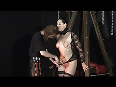 Binding the girl in boots in her dungeon tubes