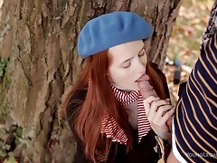 Redhead in winter clothes blows him outdoors tubes