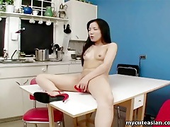 Asian amateur gets dirty in the kitchen tubes