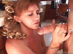 Busty lady on the table laid in her cunt tubes