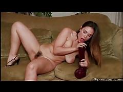 Curvy girl with hairy vagina masturbates with dildo tubes