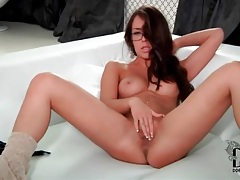 Tasty girl in glasses plays with her pantyhose tubes