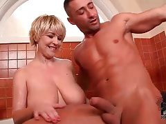 Fat girl gives him a titjob in the bathtub tubes