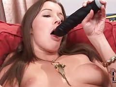 Hottie licks and fucks with her black dildo tubes