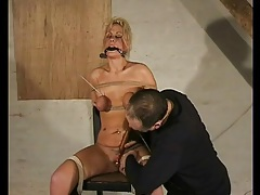 Tied and gagged girl buzzed by a toy tubes