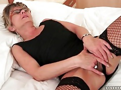 Solo old lady in glasses and fishnets masturbates tubes