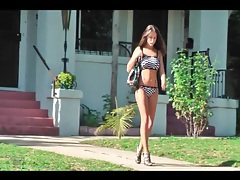 Good looking chick walking in her bikini tubes