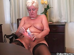 Chubby granny in stockings plays with vibrator tubes