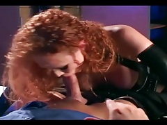 Sexy redhead getting fucked in shiny black latex tubes