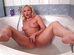 Flexible blonde in stockings takes a bath tubes