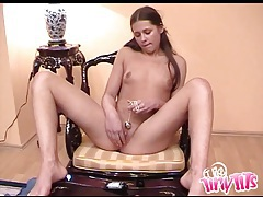 Teen slides pleasure beads into her wet pussy tubes