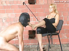 Hottie in black satin pants gets feet licked tubes