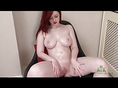 Curvy redheaded girl rubs oil into her body tubes
