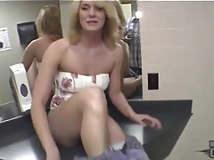 Girl in short dress shows off in hotel bathroom tubes