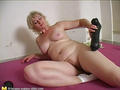 Tight cunt of mature blonde takes dildo tubes