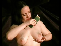 Solo bdsm girl drips wax on her titties tubes