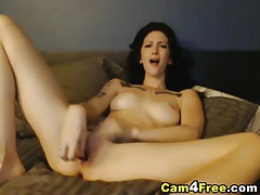 Sexy tattoo babe fingering and cumming on webcam tubes
