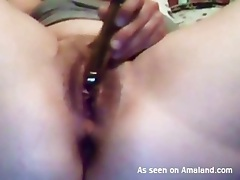 Toy held against the clit masturbates the girl tubes