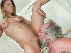 Old man licks dominant young pussy in shower tube