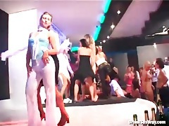 Girl in leather pants dances under a shower tubes