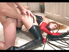 Wild babe in latex lingerie and a corset fucking tubes