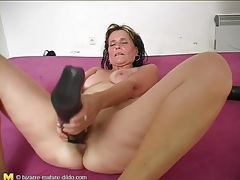 Thick black dildo pushes into mature pussy tubes