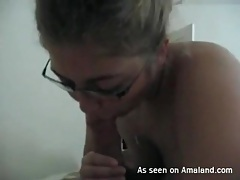 Curvy girl in sexy glasses sucks on dick tubes