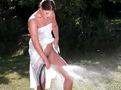 Girl washes pussy with a hose outdoors tubes