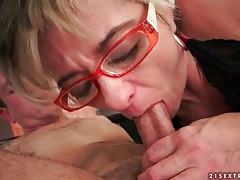 Skinny lady wears glasses and sits on dick tubes
