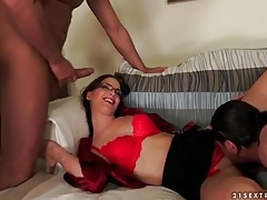 Sexy chick in glasses sucks on three dicks tubes