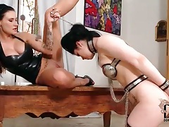 Sub girl in metal chastity lingerie submits tubes