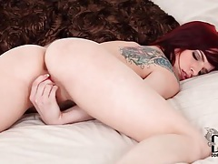 Redhead with little vibrator pleasures her pussy tubes