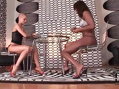 Girls in high heels play cards sensually tubes