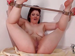 Brunette in bondage pissing on camera tubes