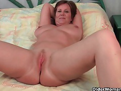 Granny loves to tease with her big tits and juicy pussy tubes
