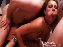 Tattooed whore in fishnets takes cock in gangbang tubes