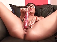 Sexy girl slides long red dildo into her ass tubes