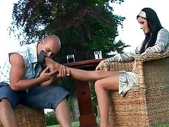 Licking the feet of girl in pretty satin dress tubes