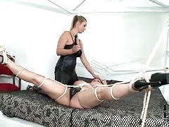 Tight leather on sexy mistress with tied up girl tubes
