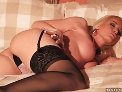 Beautiful blonde in black stockings plays solo tubes