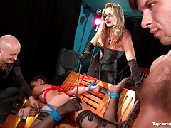 Guy sucks dildo while his girlfriend is tied up tubes