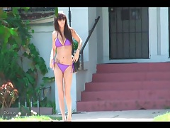 Walking down an la street in her purple bikini tubes