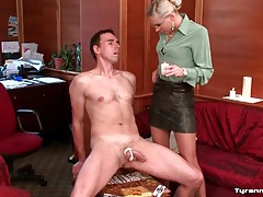She binds his cock and balls and pours hot wax tubes
