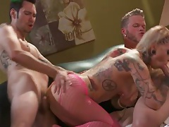Blonde covered in tattoos fucked by two horny guys tubes