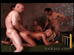 Skinny blonde licked and fucked in gangbang tubes