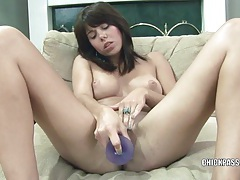 Brunette coed mina plays with her toy tubes